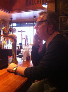 For Arts Sake owner, Brian Davis, talking business on the phone as we sip on a coffee waiting for Prezzo to open.