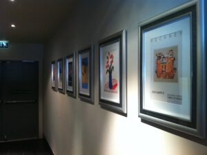 Six pictures hung successfully in a row.