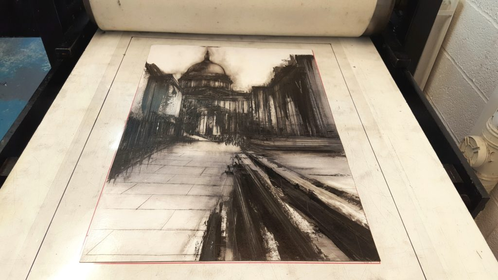 Etching of London and St Paul's Cathedral by Clare Grossman on the printmaking press